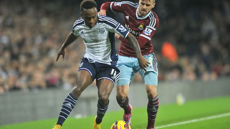 West Bromwich Albion's Saido Berahino (left) and West Ham United's Carl Jenkinson battle for the bal