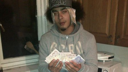 Dautzenberg posing in a mobile phone photo with criminal money on March 26