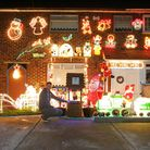 Andrew Yeomans with the Christmas lights decorating his house