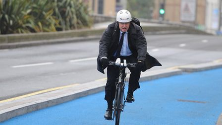 Boris on a bike... arriving at launch of cycle superhighway in Stratford