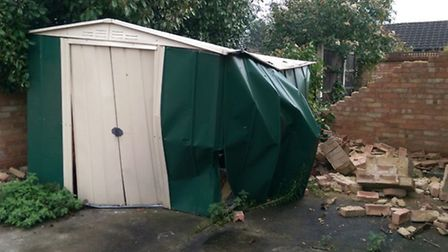 Car crashes into garage in Sarre Avenue, Elm Park. Picture: Emma Moyes