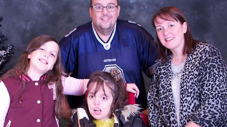 Caitlin Inns, left, with her sister Olivia and parents Mike and Nat