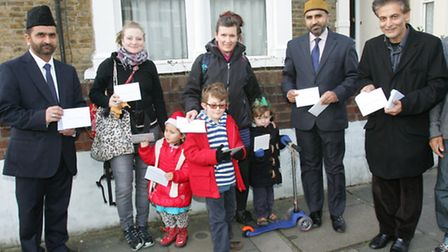 Seasonal cards were given to passing families