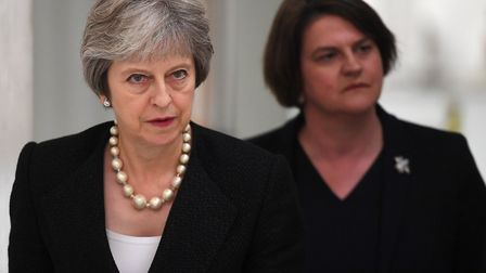 Prime Minister Theresa May (left) and Arlene Foster, the leader of the Democratic Unionist Party (DU
