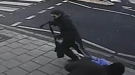 One man makes off with the victim's bag