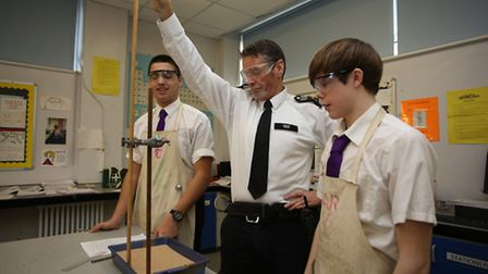 Sargent Ken McNish with Year 11 students Thomas Weston, 15 and Sam Thacker, 16 in a Science lesson