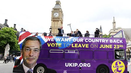 The then UKIP leader Nigel Farage passes the Houses of Parliament in London