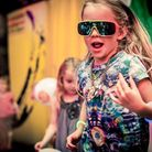 A young raver gets into the spirit of things