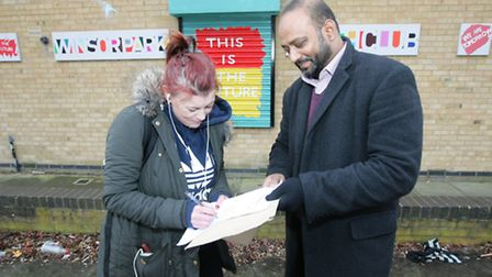 Syed Ahmed, with local resident Julia McCarthy signing the petition.