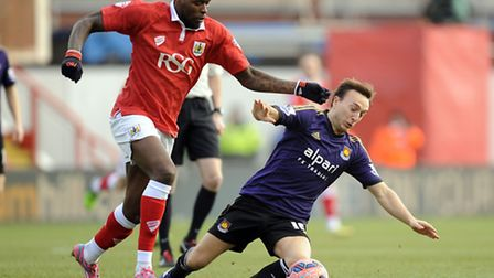 Bristol City's Jay Emmanuel-Thomas (left) and West Ham United's Mark Noble battle for the ball durin