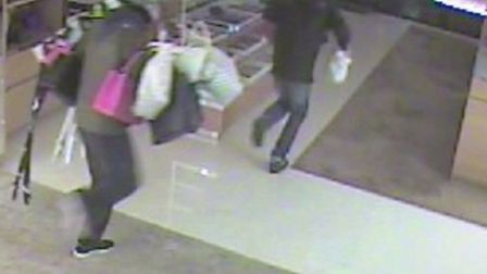 CCTV images of the gang making off with handbags and other items at the Louis Vuitton store in Sloan