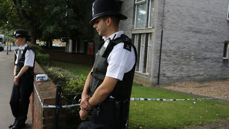Police outside the house in Broomfield Road, Chadwell Heath, where Ayesha Ali's body was found. Pict