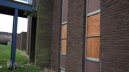 A view of the boarded up windows at the Long Term Conditions Centre