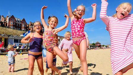 Familys enjoy the August sunshine on Lowestoft beach.The Jacobs and Willis family having fun on Lowe