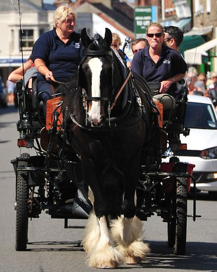 August sunshine on Southwold beach.Horse and cart rides through the town centre.