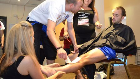 Lowestoft Town striker Chris Henderson has his legs waxed for cancer charities. Kim Bennett did the