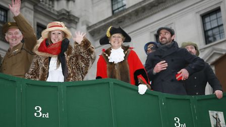 Havering's steam engine float travels through London during the New Year's Day parade