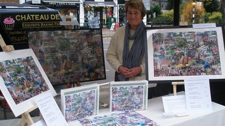 Jill Stock with her jigsaws and posters at the Wanstead Farmers' Market.