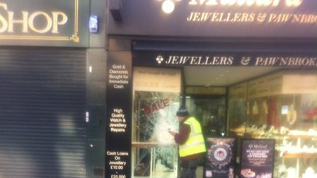 A worker was seen fixing the shop front on Friday, the day after the robbery
