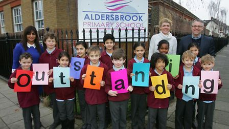 Aldersbrook head Misbah Mann, back-left, governor Lady Tracey Adebowale-Jones, back-right-centre, an