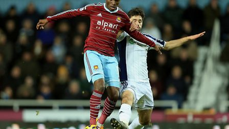 West Ham United's Enner Valencia and West Bromwich Albion's Claudio Yacob compete for the ball durin