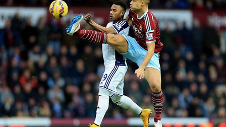West Ham United's Winston Reid and West Bromwich Albion's Stephane Sessegnon compete for the ball du
