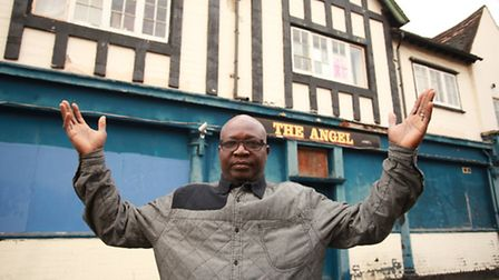 Pastor Rufus Akintimehin outside The Angel pub which he is hoping to convert into a church