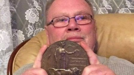 Paul Jenkins with the Dead Man's Penny he found more than 30 years ago in Gidea Park