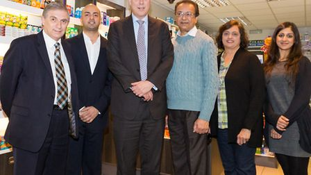 (L to R) Lee Scott MP, Pharmacy co-owner Vishal Pattani, Minister for Justice, Chris Grayling, fathe