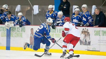 London Raiders players look on as Bailey Wootton goes on the attack at Streatham (pic: John Scott)