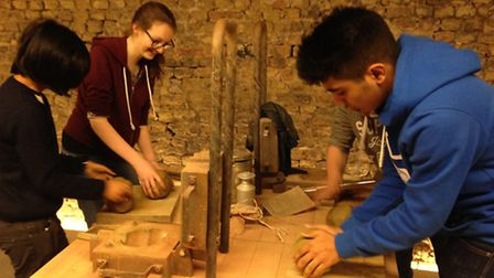 Pupils Joy Sustituya and Mary Karayel, 16, from Our Lady's Convent High School, in Hackney, making c