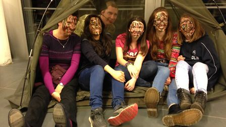 Pupils and a soldier after having their faces camouflaged. Picture: Erica Spurrier/Equity