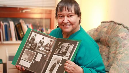 Princess Maria Sviatopolk-Mirski holds an album with old pictures and is pictured at her home in Str