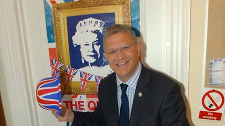 Diamond Jubilee Extravaganza at Margaret Thatcher House - Andrew Rosindell M.P. with the jubilee cak