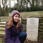 Reporter Beth Wyatt at the grave of her great-great uncle Sidney Stone, in the Somme. Picture: Erica