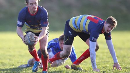 Luke Taylor looks to make a pass for Old Cooperians against Diss (pic: Gavin Ellis/TGSPHOTO)