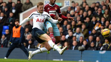 Tottenham Hotspur's Eric Dier tackles West Ham United's Diafra Sakho during the Barclays Premier Lea
