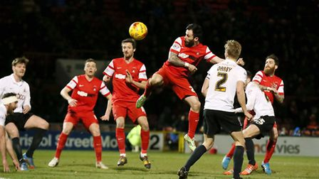 Orient forward Chris Dagnall has an opportunity to score with his headeragainst Bradford City (pic