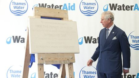 The Prince of Wales, President of WaterAid, unveils a plaque at Abbey Mills Pumping Station to mark