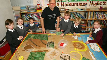 School children at St Joseph's Catholic Primary School in Upminster, are making a mosaic with award