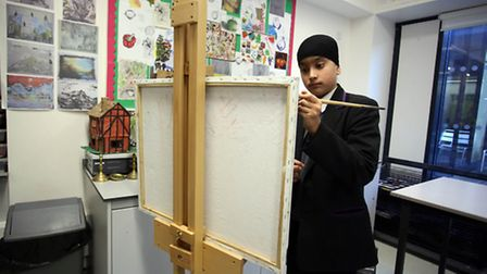 Pupil at Isaac Newton Academy in Ilford, Harry Taak, 13 who has won a competition to get his art wor