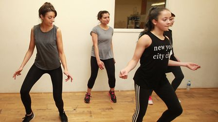 Reporters Anna Silverman (left) and Janine Rasiah (middle) try to follow the moves