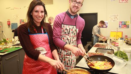 Helen Holman and Recorder reporter Mark Shales enjoy a cooking class organised by Share East.