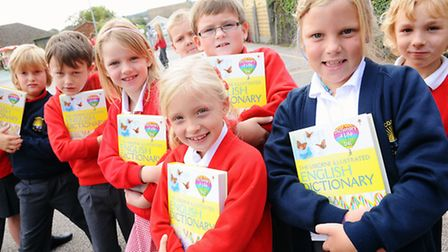Local rotarians who have presented dictionaries to pupils at Corton Primary School.