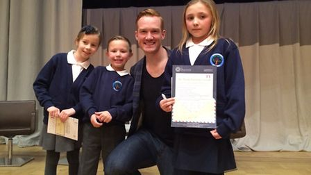 The thoughtful Chloe Trew, Finley Livingstone and Ellie Jo Stapleton with Olympian Greg Rutherford a