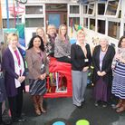 Staff from Orchard/Ray lodge and Oakdale Children's Centres are congratulated by Cllr Elaine Norman