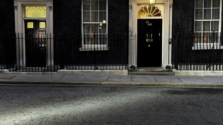 A light from a TV camera lights a pathway toward Number 10 (Pic by Andrew Matthews/PA)