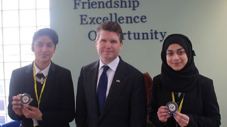 Anisa Lone and Larreb Butt, with US ambassador to the UK Matthew Barzun. Picture: Seven Kings High S