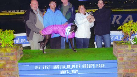 Elliot Barclay, right, handing over a trophy at Coral Romford Greyhound Stadium. Picture: Redbridge