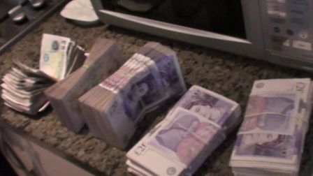Cash found in microwave. Picture: National Crime Agency
